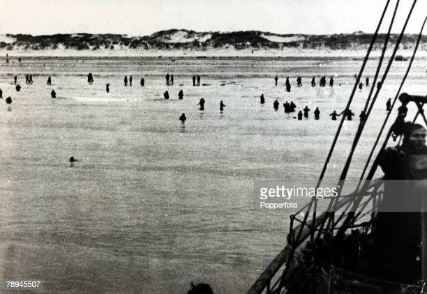 May/June 1940 The Battle of Dunkirk The silhouettes of British soldiers wading into the sea in the hope of being picked up by the rescue ships The...