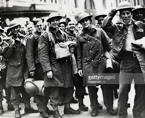 May/June 1940 The Battle of Dunkirk Men of the British Expeditionary Force in good spirits as they arrive at a London railway station on their return...
