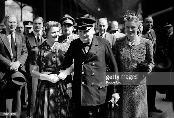 War and Conflict World War II Politics pic 27th June 1942 British Prime Minister Winston Churchill with his wife Clementine right and daughter Mary...