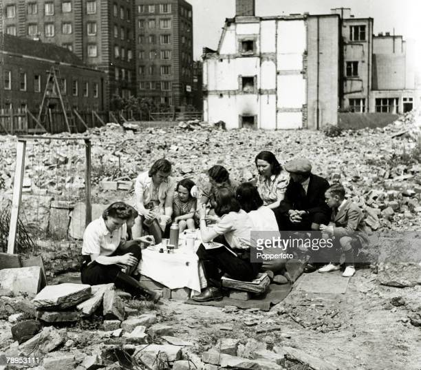 War and Conflict World War Two Air Raids pic June 1942 Great Britain A group of people sit amongst the rubble in Chelsea London to have a picnic...