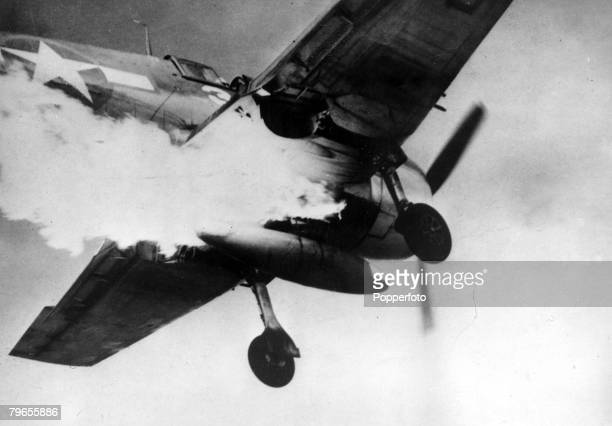 War and Conflict World War Two Air War pic December 1944 This dramatic picture shows an American Grumman Hellcat with flames belching from below the...