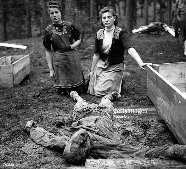 War and Conflict World War Two Atrocities pic 1945 The body of a slave worker having been murdered by German Nazis at Saltau is shown to two local...