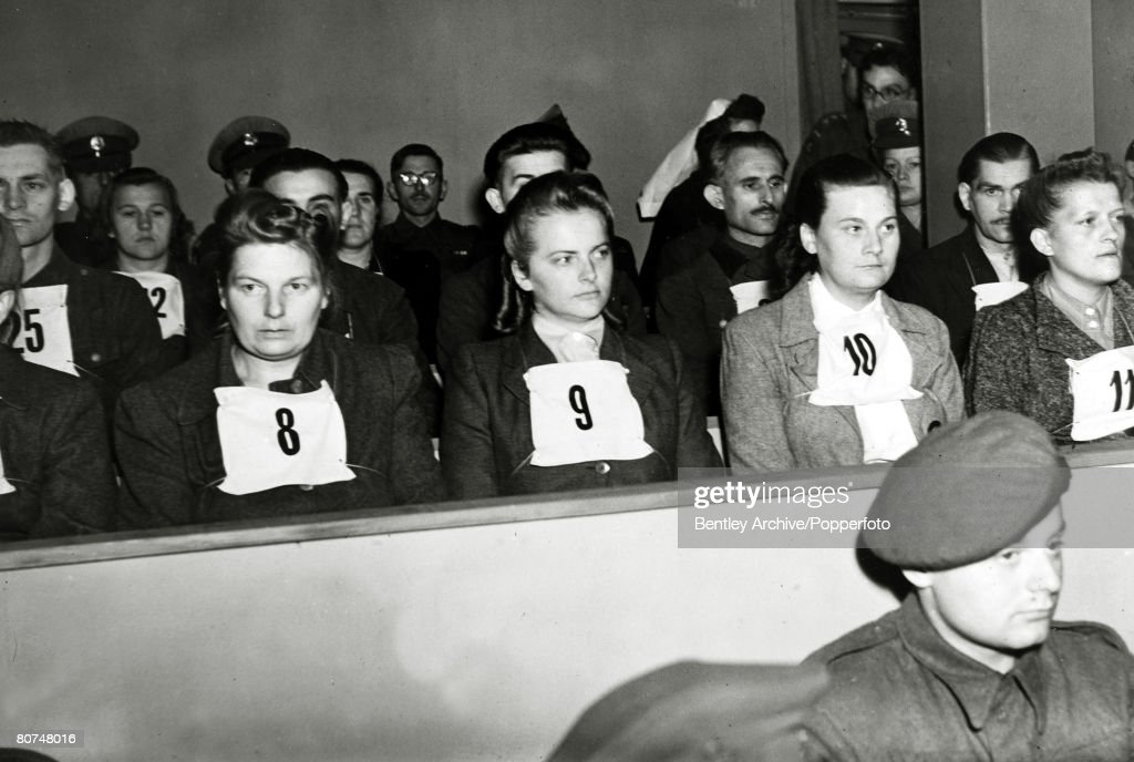 War and Conflict, World War Two, Atrocities, pic: September 1945, Irma Grese, born 1923, German camp guard, (wearing card 9) perhaps the most notorious female Nazi war criminal, pictured at the Belsen Trial, She committed grave crimes at Ravensbruck, Auschwitz and Bergen Belsen concentration camps, She was hanged for war crimes in December 1945