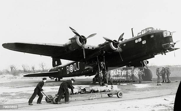War and Conflict World War Two Aviation pic Armourers and crew preparing a Short Stirling fourengined heavy bomber of No149 Squadron Royal Air Force...