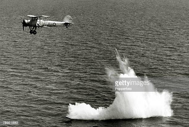War and Conflict World War Two Aviation pic circa 1941 A British Fairey Swordfish biplane torpedo bomber launches a torpedo The Swordfish which even...