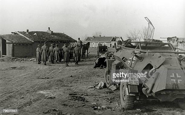 War and Conflict World War Two Eastern Front pic circa 1942 Soldiers alongside a German armoured vehicle in a village southwest of Stalingrad