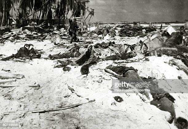 War and Conflict World War Two Far East Dead Japanese soldiers litter the beach at Tarawa after American forces had taken control following victory...