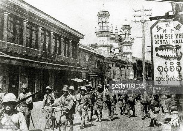 War and Conflict World War Two Far East pic 1942 Japanese soldiers marching in downtown Moulmein during the fall of Rangoon