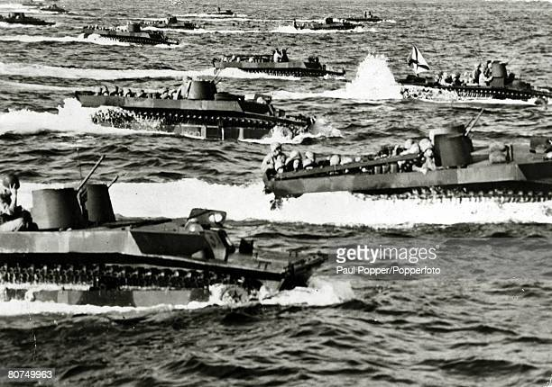 War and Conflict World War Two Far East pic 1944 American amphibious tracked vehicles in the water close to the Futatsune Beach on the well defended...