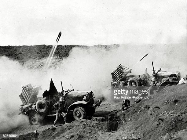 War and Conflict, World War Two, Far East, pic: circa 1944, United States Marines operate mobile rocket launchers from rocket artillery trucks during...