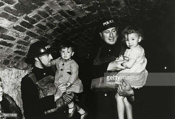 War and Conflict World War Two Great Britin pic circa 1940 Police constables with two children in an underground shelter at Dover Kent during a...