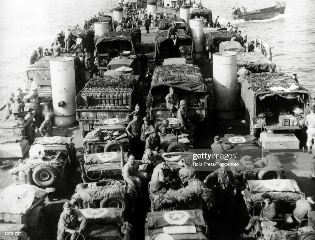 War and Conflict World War Two. (D-Day). Invasion of France. pic: June 1944. Trucks and jeeps of the 2nd French Armoured Division about to land on the Normandy beaches during the first landings of the invasion. : News Photo