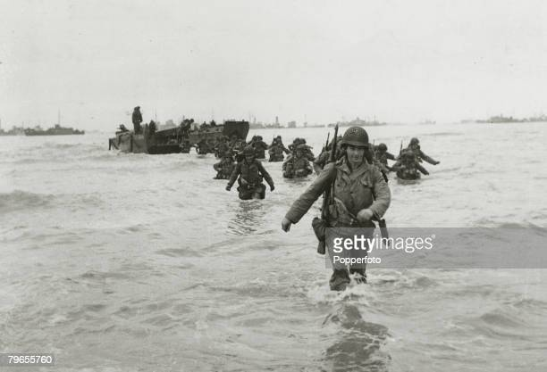 War and Conflict World War Two Invasion of France pic June 1944 American troop reinforcements wade ashore from landing craft on to the Normandy...
