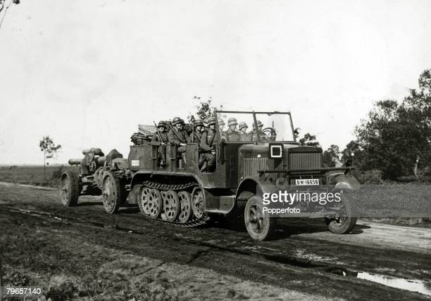 1939 A German mechanised lorry loaded with soldiers with gun trailer pulled behind