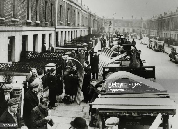 1939 Great Britain Air Raids The materials for building air raid shelters are delivered to houses in Islington London