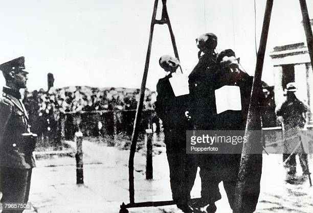 1940 Poland A German officer looks on unconcerned as 3 citizens of Warsaw are hanged in a public square