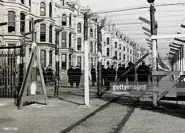 1941 Isle of Man The International Internment Camp on the Isle of Man shows the barbed wire barricade and the camp compose of hotels and boarding...