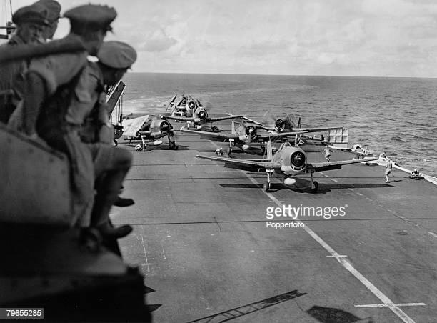 1944 Royal Navy Fleet Air Arm Grumman F6F Hellcat fighter aircraft on the deck of the British Illustriousclass aircraft carrier HMS Indomitable...
