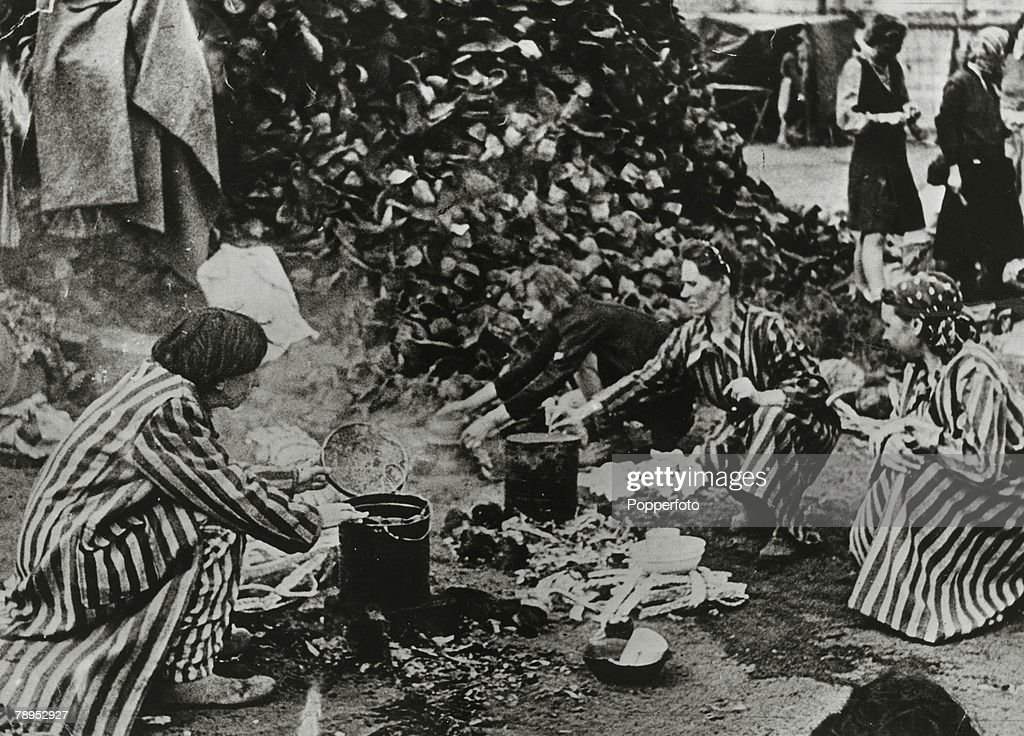 War and Conflict. World War Two. pic: 1945. Women using the boots of the dead from a huge pile at the Bergen Belsen German Nazi concentration camp. : News Photo