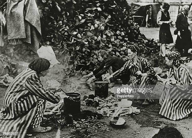 1945 Women using the boots of the dead from a huge pile at the Bergen Belsen German Nazi concentration camp