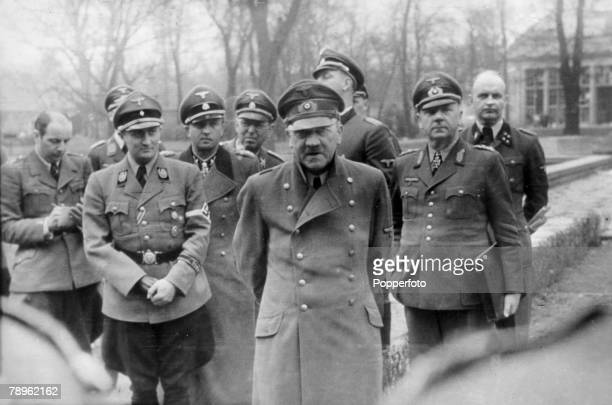 20th April 1945 Germany's leader Adolf Hitler pictured with some of his officers some 10 days before he committed suicide in the last hours before...