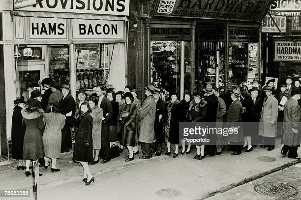 24th March 1943 United States A New York City queue with people lining up at food stores before rationing starts