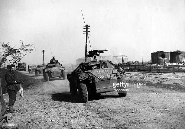 April 1945 British armoured cars drive into recently captured Arnhem