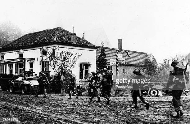 April 1945 British infantry pass a road sign on the road to Arnhem during the second battle for the town
