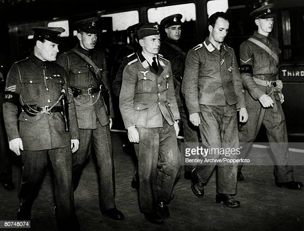 August 1940 Captured German airmen being escorted by military police on their arrival at a London railway station