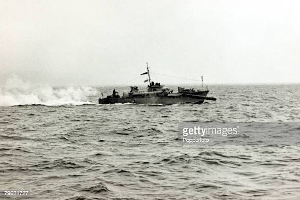 circa 1940 A British Royal Navy MTB firing a torpedo at full speed