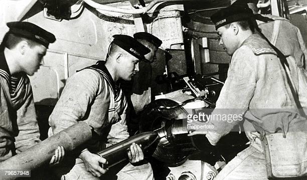 circa 1941 A gun crew on the Russian battleship 'October Revolution' of the Baltic fleet showing the sailors loading a shell
