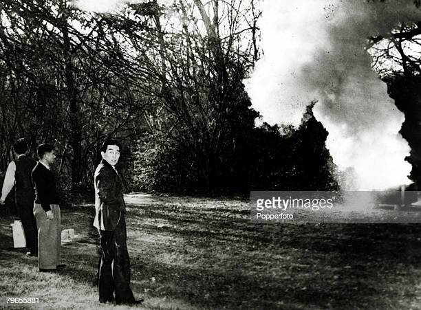 December 1941 Officials from the Japanese Embassy in Washington destroy papers and documents in the garden of their Embassy after the treacherous...