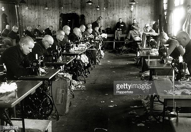 February 1941 Inmates working in the tailor's at the German concentration camp at Sachsenhausen The camp opened in 1936 and the Nazis held Jews and...