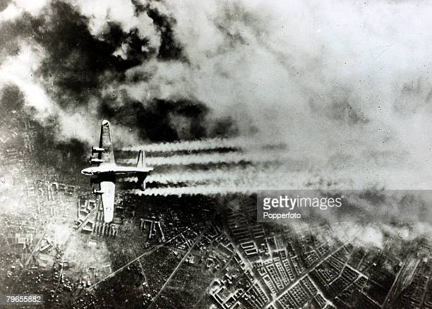 February 1945 An American B17 Flying Fortress pictured making a daylight raid over Berlin with the sky full of smoke