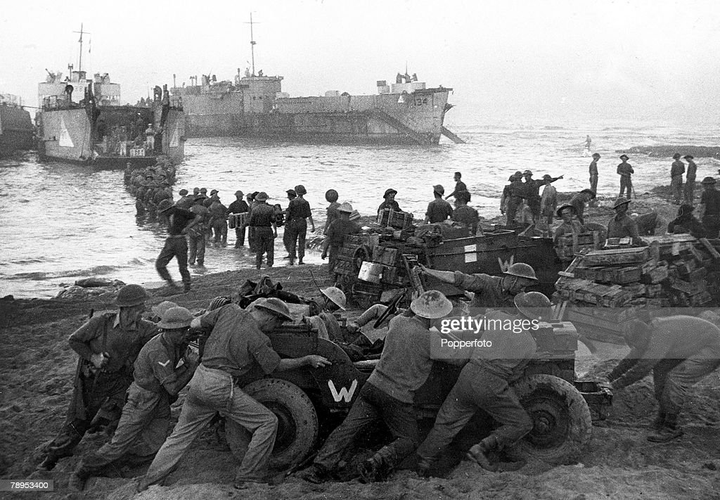 War and Conflict. World War Two. pic: July 1943. Allied troops unloading supplies on the beach during the invasion of Sicily. : News Photo