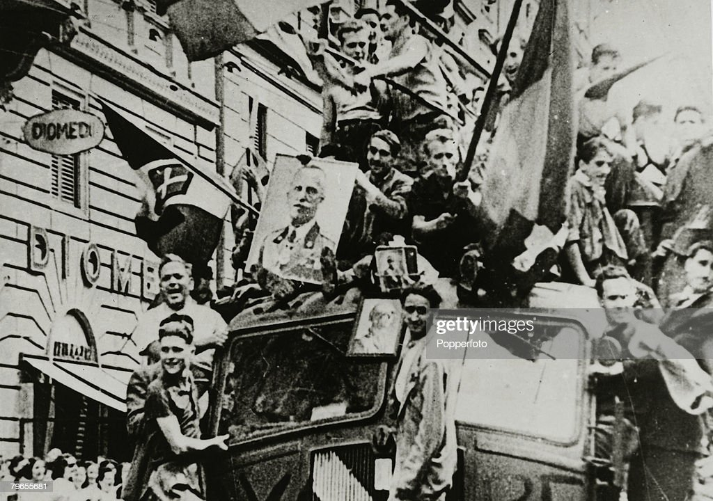 War and Conflict, World War Two, pic: July 1943, Italians out in Rome celebrating the downfall of Benito Mussolini wave Italian flags and show pictures of King Victor Emmanuel : News Photo