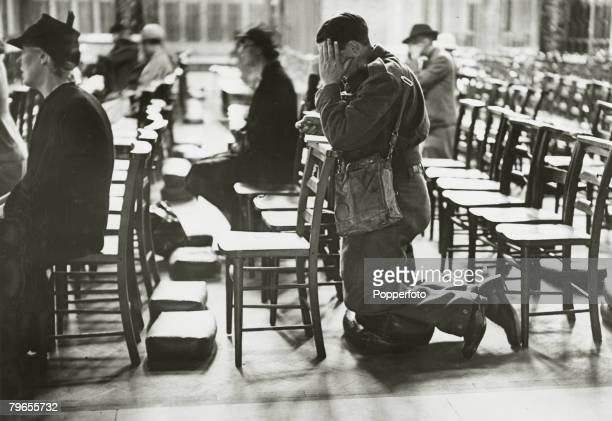 June 1940 Great Britain A British soldier kneels as he prays in Westminster Cathedral shortly after the evacuation at Dunkirk