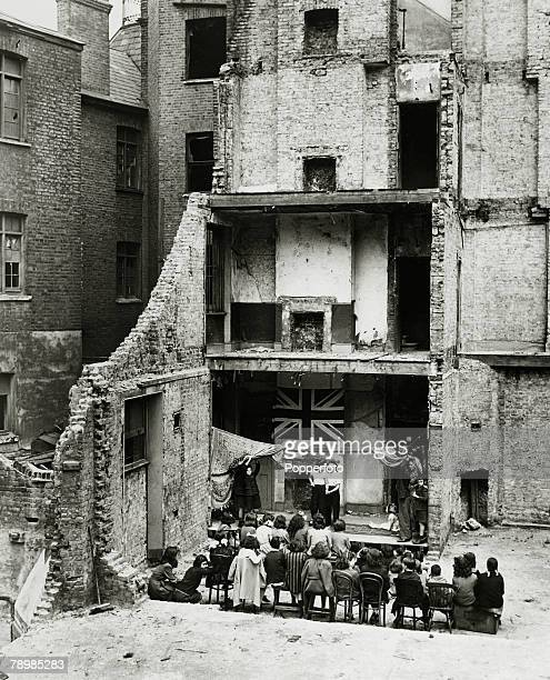 June 1943 Leisue / Britain A ' concert' performance is held in a 'blitzed' building in aid of war aid charities