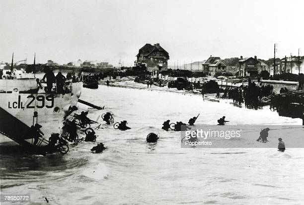 War and Conflict, World War Two, pic: June 1944, Canadian troops go ashore with their bicycles on Juno Beach during the Normandy landings as the...