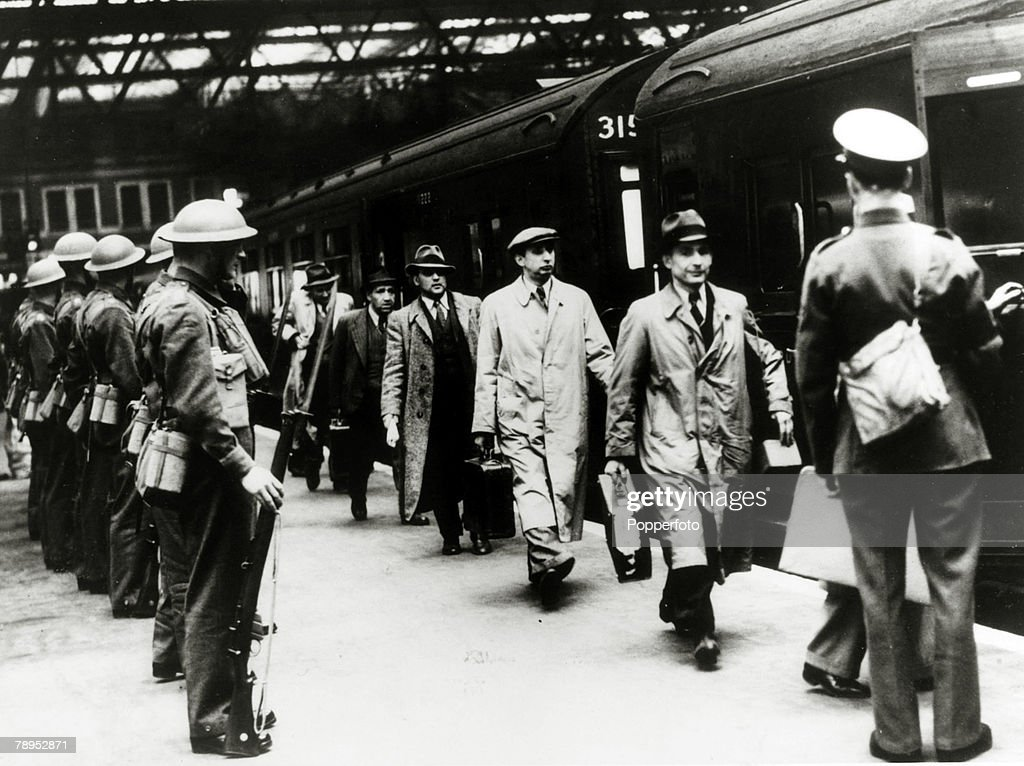 War and Conflict. World War Two. pic: May 1940. Men of German and Austrian origin being rounded up and being taken into internment camps, pictured here at a London station. : News Photo