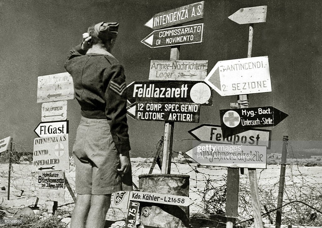 War and Conflict World War Two. pic: November 1942. The retraeting Axis forces having pulled out of Mersa Matruh, Egypt, leave behing a mass of signs in German and Italia which perplexes this British Army sergeant. : News Photo