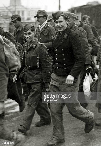 October 1944 England Captured German 'young' soldiers seem glad to be out of the war as they become prisoners of war after being taken prisoner by...