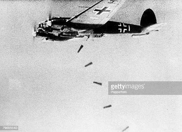 September 1939 A German Heinkel 111 releases a stick of bombs on to it's target