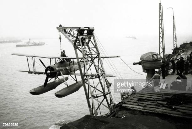 War and Conflict World War Two Royal Navy pic circa 1940 A Fairey Swordfish biplane torpedo bomber aircraft is lifted from the British aircraft...