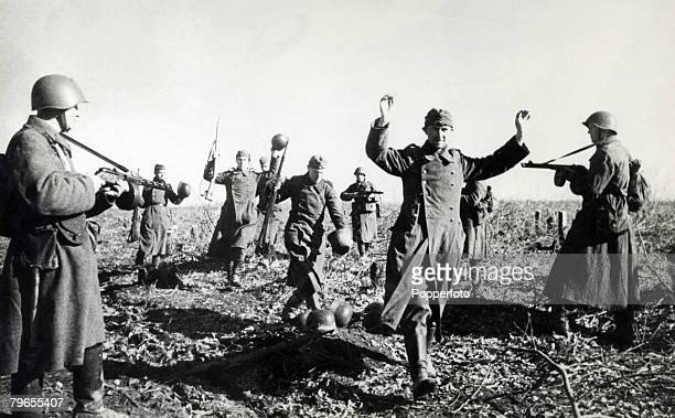 War and Conflict World War Two Russian Western Front July 1942 German soldiers with their hands up surrender to troops of the Red Army after a battle...