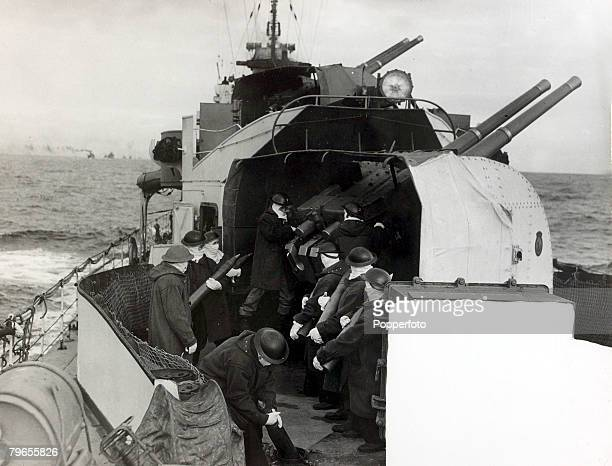 War and Conflict World War Two Sea War pic 1942 Men manning a 4 inch gun on board a British destroyer The men all wear full antiflash kit as the...