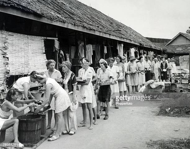 War and Conflict World War Two Singapore British women civilian Internees queue up for their food at the camp mess area