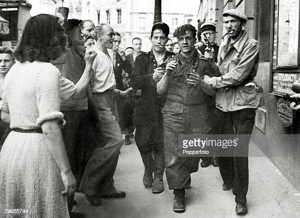 War and Conflict World War Two The Liberation of Paris pic August 1944 A German sniper is marched away by the FFI as local people jeer and shake...