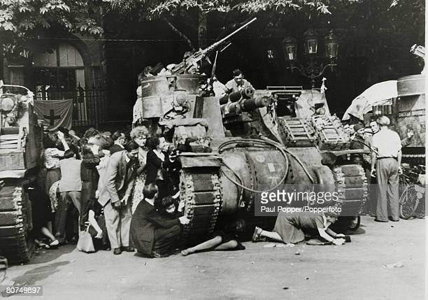 War and Conflict World War Two The Liberation of Paris pic August 1944 People hiding behind and even under a tank during the fighting for the...
