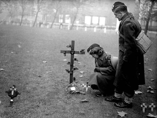 War and ConflictWorld War II People pic11th November 1941 A simple ceremony by two people in military uniform on Remembrance Day